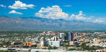 Tucson Downtown skyline w/ the Santa Catalina mountain range and clouds in the background